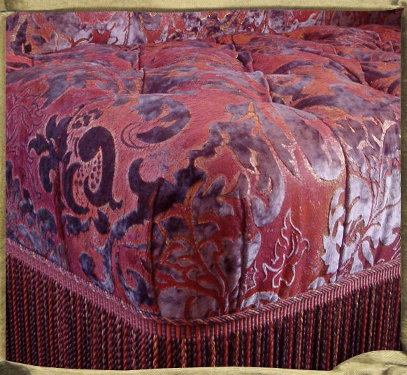ANNAM pink, red and gold on Dusty mauve silk velvet on sofa by Decours,Paris.